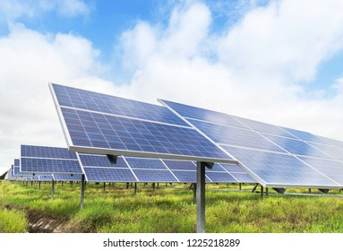 Close up rows array of polycrystalline silicon solar cells or photovoltaics in solar power plant turn up skyward absorb the sunlight from the sun alternative renewable energy on blue sky background