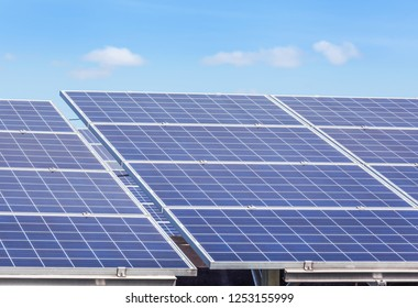 Close up rows array of solar cells or photovoltaics in solar power station convert light energy from the sun into electricity alternative renewable clean energy from the sun