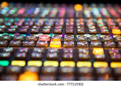 close up of rows of buttons on a vision mixing panel, with narrow depth of field.