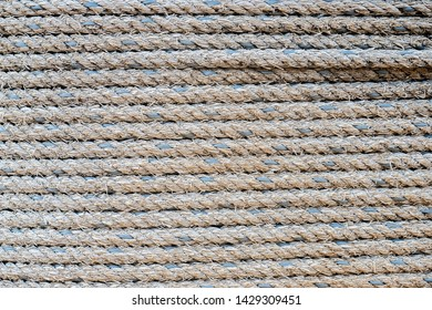 Close up of rows of thick twisted rope cable in lines. For pattern, texture, background