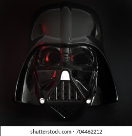 Close up of a Rubies Star Wars Darth Vader Halloween mask with studio lighting