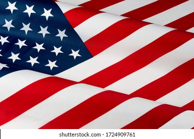 Close up of ruffled American flag. Satin texture curved flag of USA. Memorial Day, 4th of July. Banner, freedom concept
