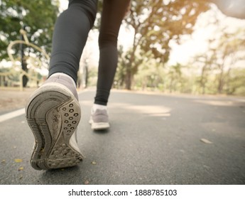Close up run shoes and leg of runner in the park