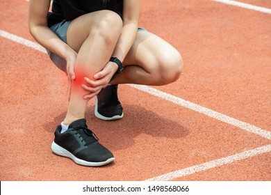 Close up of runner woman holding her calf, suffering from calf pain. after running. Conceptual of injury from running workout.