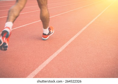 Close up Running track with blur of runner feet in stadium