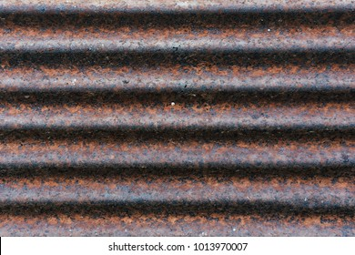 Close - up of the rust on zinc and pattern of brown rust, The old zinc with dot, Abstract background by rust.