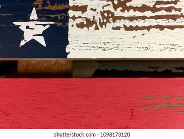 Close up of a rustic flag painted on old wood