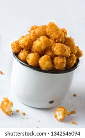 close up of rustic fried golden potato tater tots