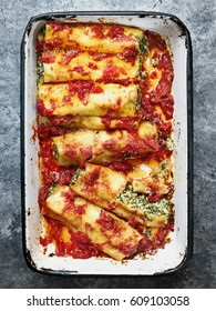 close up of rustic italian spinach ricotta cannelloni pasta