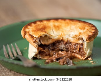 close up of rustic meat and mushroom pie