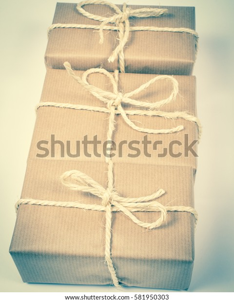 Close up of the rustic parcels gift box with kraft paper.