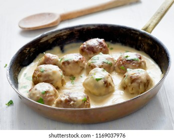 close up of rustic swedish meatballs in a pan