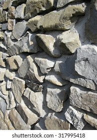 close up rustic wall built with stones