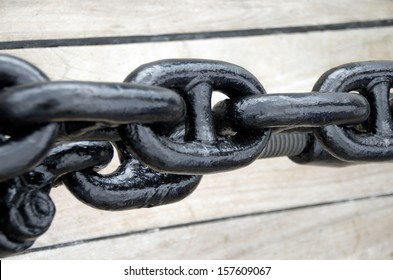 Close up of a rusty anchor chain of a sailboat