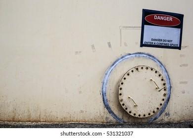 Close rusty manhole on the white fuel tank