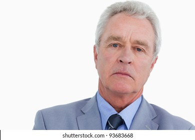Close up of sad looking mature tradesman against a white background