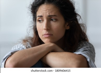 Close up sad woman sit indoor feels offended by beloved man. Female thinking about loneliness and solitude, see no way out of difficult life circumstances. Divorce break up, abortion decision concept