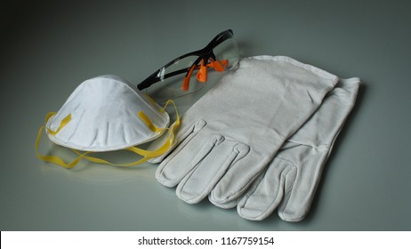 Close up Safety eye wear, air filter, leather gloves, personal protective equipment