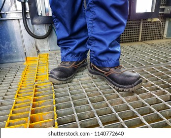 Close up safety shoes's men use for protection accident in factory.