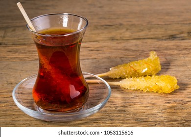 Close Up Of Saffron Rock Candy Sugar Crystal in Black Tea Cup Is Often Used To Be Dissolved In Tea In Iranian Persian Cuisine