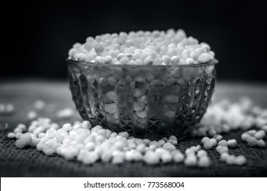 Close up of Sago pearls in a blue colored transparent bowl.