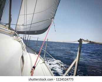 Close up of sail ship heading the open sea
