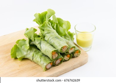close up salad mixed tuna crab pork vegetable roll in noodle tube on Chopping board white background.