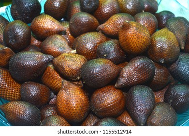 Close up of Salak (Salacca/Zalacca) fruit for sale at market. Salak is a tropical fruit from Indonesia