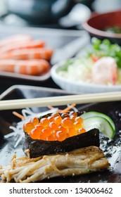 close up Salmon roe sushi  with cucumber  and fried enokitak mushrooms