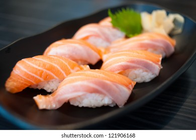 Close up of Salmon Sushi Set on Black Dish