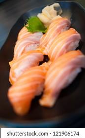 Close up of Salmon Sushi Set on Black Dish