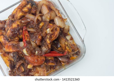"Close up ""sambal ayam"" over white background. Sambal ayam is very popular dish in Malaysia that eat together with rice. Spicy taste and red in colour."