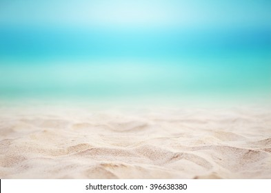 Close up sand with blurred sea sky background, summer day, copy space or for product.