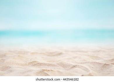 Close up sand with blurred sea sky background, summer day, copy space or for product. Summer background concept.