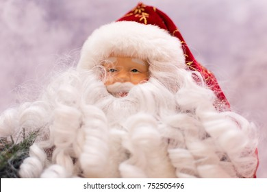 Close up of Santa Claus ornament on a blurred winter background