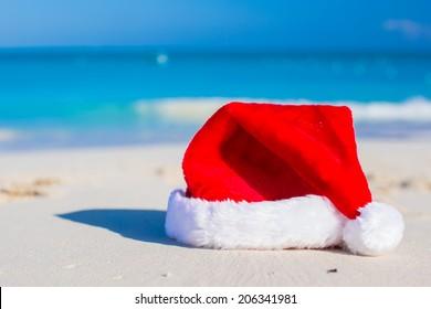 Close up Santa hat on a white sandy beach