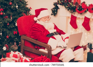 Close up of santa, study list of children's wishes and gifts on device, ready to make dreams come true, bring happiness to kids. Holly jolly x mas, noel coming