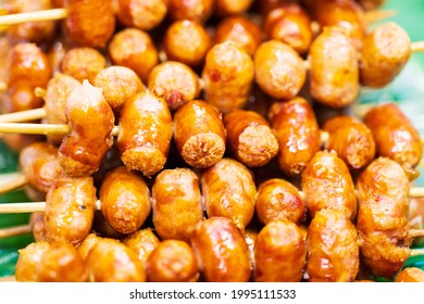 Close up of sausage grilled Thai traditional style, Sai krok isan, pork and rice, thai street food market - Shutterstock ID 1995111533