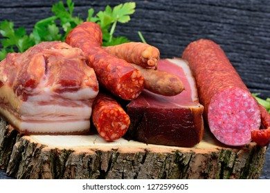 Close up of sausages and parsley on wood cutting board