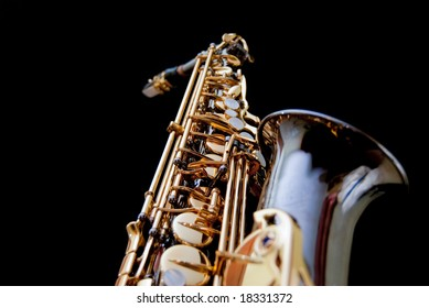 Close up of a saxophone isolated in black background