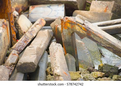 Close up scattered concrete and steel debris and rubble of  collapsed building.