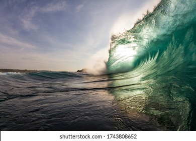 close up scene of a massive wave breaking on a reef while swimming