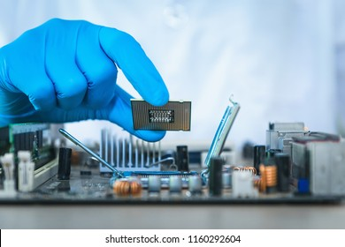 Close up of scientist hand holding computer microchip., Technology computer concept.