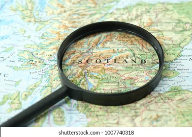 Close up of Scotland under a magnifying glass on a map