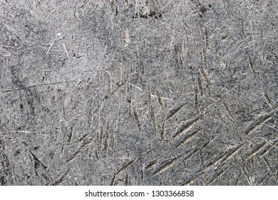 close up of scratched and dented distressed aluminum background