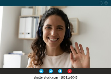 Close up screen view portrait of smiling Caucasian woman in headphones talk on video call wave greet. Happy female teacher or trainer have webcam virtual lesson or online digital training conference.