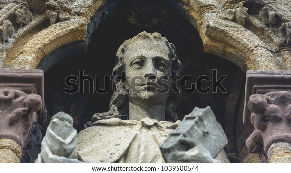 Close up Sculpture above Entrance of St John The Evangelist Church in Taunton England, Low Angle Shallow Depth of Field Architecture Details Black and White Tone