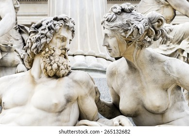 A close up of a sculpture of a man and women gazing lovingly into each others eyes. Located in Vienna Austria.