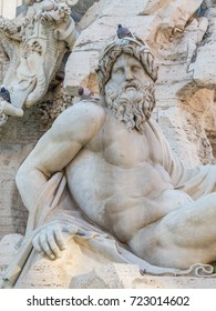 Close up of the sculpture of the river-god Ganges in the Fountain of the Four Rivers (Italian: Fontana dei Quattro Fiumi) in Piazza Navona, Rome, Italy
