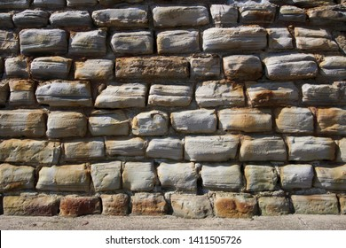 Close up of sea wall on the coast at Scarborough, Yorkshire, UK